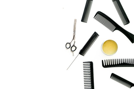 female hairdresser desk with accessories and combs on white background top view mockup.