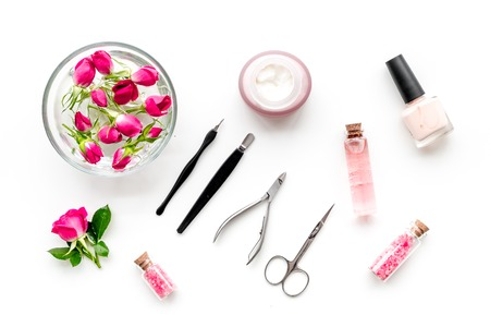 manicure tools set for nail care on white desk background top view