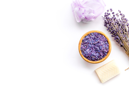 Purple spa salt near dry lavender branches and washcloth on white background top view. Stock Photo