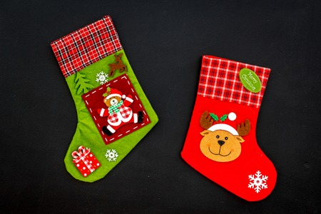 Christmas socks. Traditional decorative socks for small gifts on black background top view Stock Photo