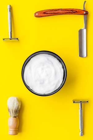 barber workspace in barbershop with equipment yellow background top view