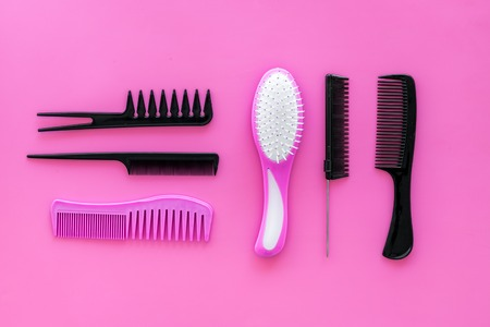 combs for hairdresser hairdresser on pink background top view Stock Photo