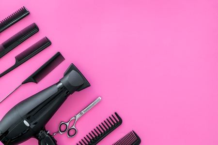 combs for hairdresser hairdresser on pink background top view mock-up.