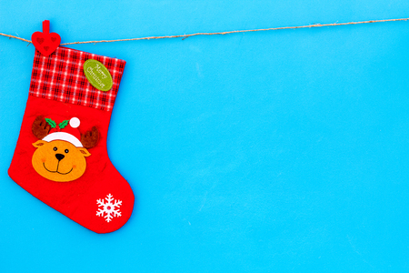 Decorative christmas socks. Empty socks for gift hanging off a thread on blue background top view space for text Archivio Fotografico