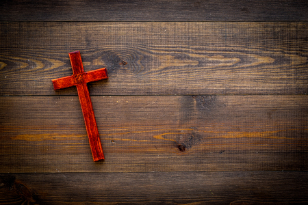 Funeral concept. Wooden cross on dark wooden background top view copy space Stok Fotoğraf