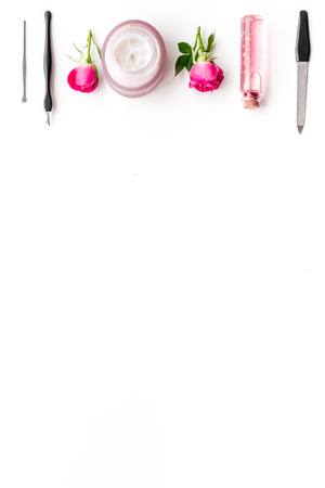 manicure tools set for nail care on white desk background top view mock up