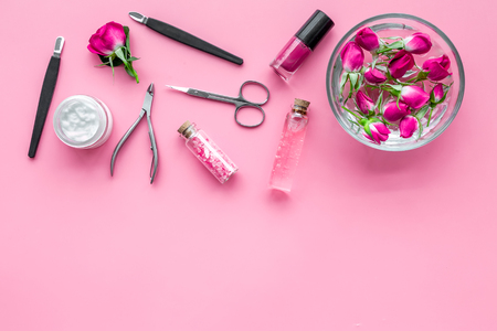 tools for manicure with spa salt and rose on pink background top view mockup