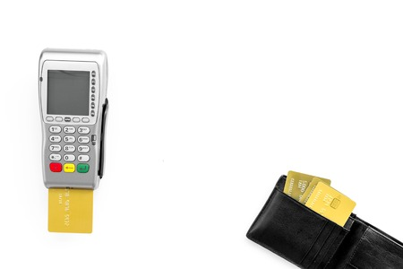 Pay by bank card, pay by credit card. Payment terminal near card and wallet with bank and credit cards on white background top view space for text