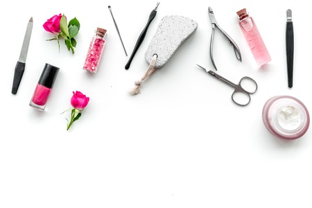 Tools for manicure with spa salt and rose on white desk background top view mock up
