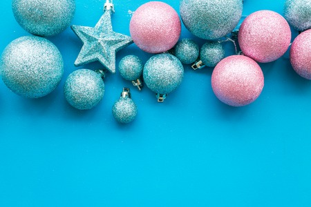 Toys for New Year tree 2019 background. Blue and pink balls and stars on blue background top view. Stock Photo