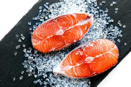 Fresh salmon steak for cooking healthy food on white table background top view