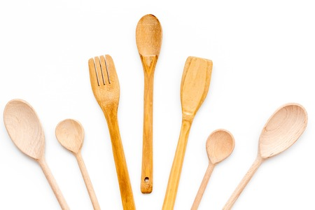 Village table with wooden cutlery set on white background top view Stockfoto