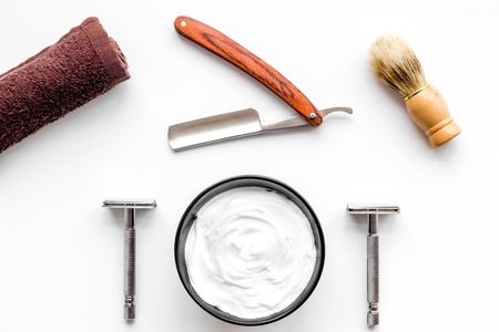 Instruments of male hairdresser barbershop top view on white desk background