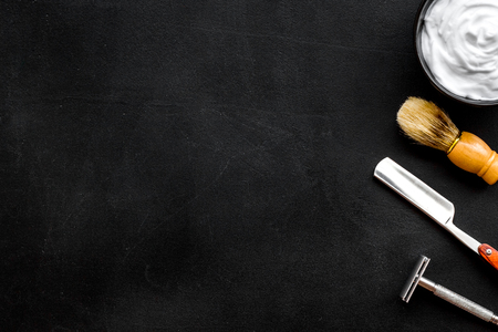 Barbershop desk with tools for male care on dark background top view mock-up Stock Photo