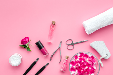 Tools for manicure with spa salt and rose on pink desk background top view mockup 스톡 콘텐츠