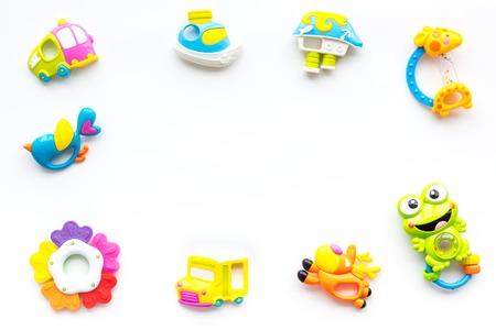 Baby care with craft toys for newborn. Rattle. White desk background top view copy space Foto de archivo - 113373716