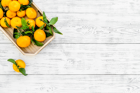 Winter fruits for New Year and Christmas. Tangerines on white wooden table background top view mock-up