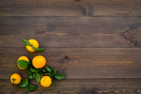 Branch of mandarins for New Year and Christmas celebration on wooden table background top view mockup