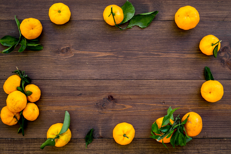 New Year and Christmas Eve with mandarins. Citrus winter fruits on wooden table background top view space for text
