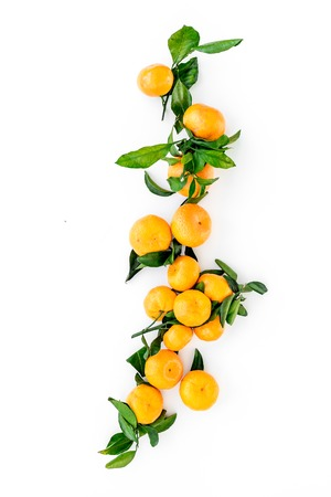 Winter fruits for New Year and Christmas. Tangerines on white table background top view Stock Photo
