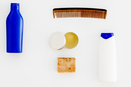 Shampoo bottle and comb for man care in barbershop on white background top view mockup 스톡 콘텐츠
