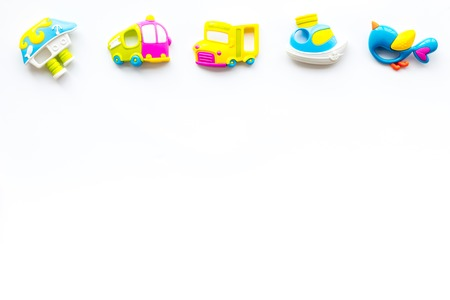 Craft toys for kids. Developing rattle for the smallest. White desk background top view mock up Foto de archivo - 113424339
