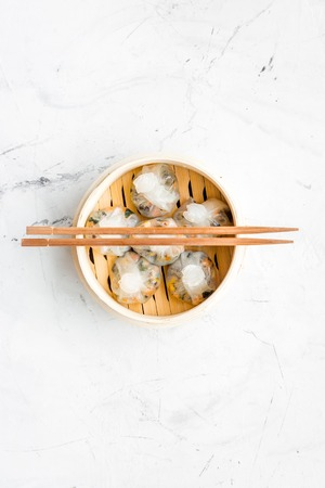 Chinese steamed dumplings Dim Sum in bamboo steamer on marble table background top view mock up Stok Fotoğraf
