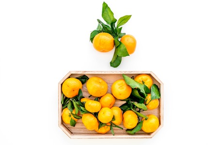 Pile of tangerines for New Year and Christmas celebration on white table background top view