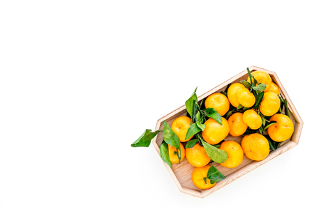 Winter fruits for New Year and Christmas. Tangerines on white table background top view mock-up Stock Photo
