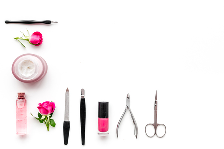 Tools for manicure with spa salt and rose on white