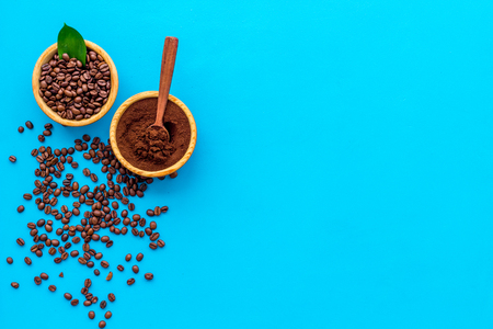 Coffee  with beans blue table flat lay space for text
