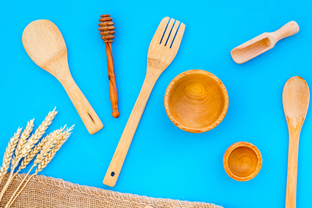 Village wooden cutlery set on blue table