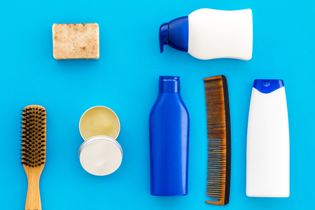 Male care set for barbershop with shampoo bottle and comb on light blue desk 스톡 콘텐츠
