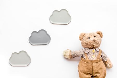 Craft toys for kids. Handmade teddy bear. White desk