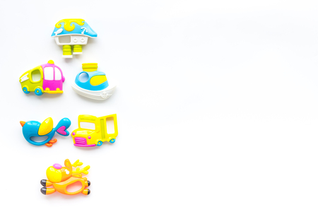 Toys for newborn baby set with plastic rattle on white Foto de archivo - 113592154