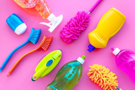 Housekeeping tool. Detergents, soap, cleaners and brush for house cleaner work on pink