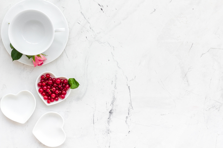 Table setting with plates, wine berry and flower on stone kitchen table Stockfoto