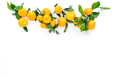 Branch of mandarins for New Year and Christmas celebration on white table