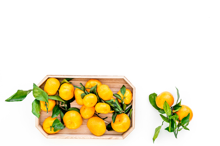 New Year and Christmas Eve with mandarins. Citrus winter fruits on white table background top view space for text Stock Photo