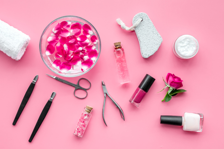 manicure and pedicure equipment for nail bar set on rose background top view Stock Photo