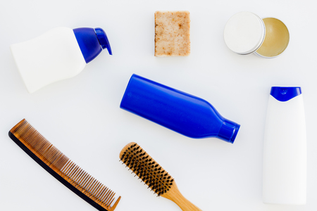 shampoo bottle and comb for man care in barbershop white background top view mockup