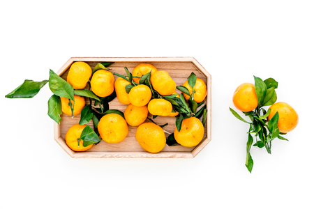 pile of tangerines for New Year and Christmas celebration on white background top view Stock Photo