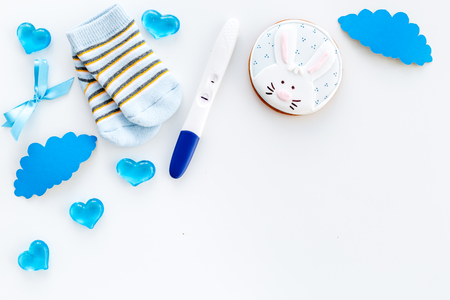 Pregnancy test, socks and hearts white background top view mock up 写真素材