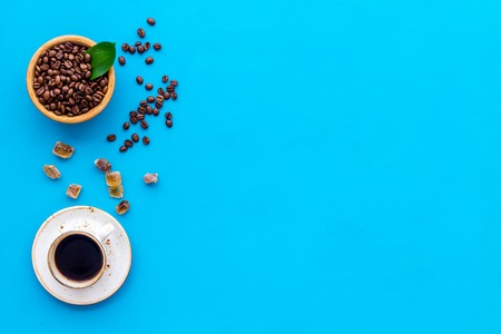 coffee bean and cup of americano on blue table background top view mockup Stock Photo