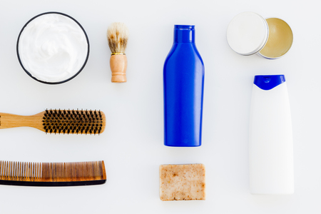 Instruments of male hairdresser with shampoo and comb in barbershop top view on white background mock up 스톡 콘텐츠