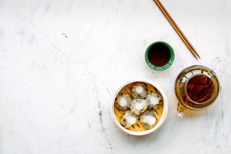 Chinese food set with dim sum, sticks and tea on marble background top view copy space Stock Photo