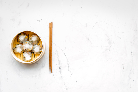 Dinner in Chinese restaurant with dim sum, stick on marble background top view space for text