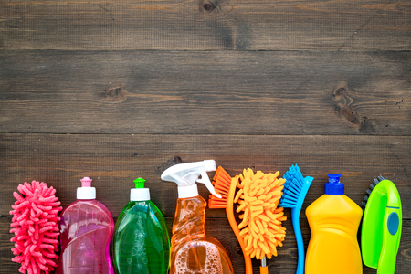 Housekeeping set. Detergents, soap, cleaners and brush for housecleaning on wooden background top view mock-up Stockfoto