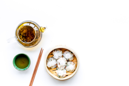 Chinese food set with dim sum, sticks and green tea on white background top view copy space Stock Photo