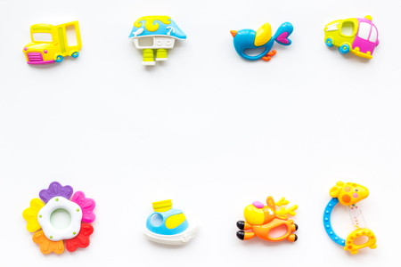 Craft toys for kids. Developing rattle for the smallest. White background top view mock up Foto de archivo - 113858116